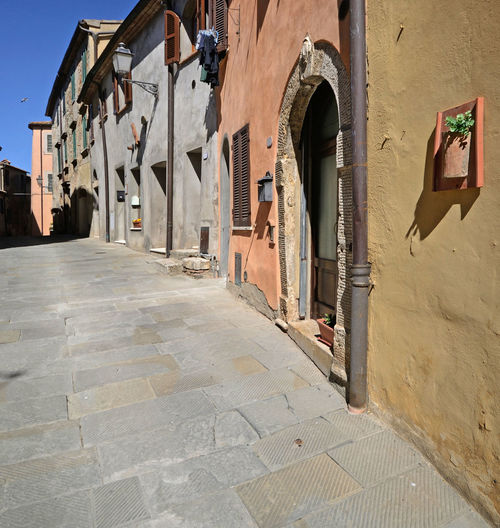 alley view of San Casciano dei Bagni, Tuscany, Italy Ancient Old Street Building Architecture Built Structure Building Exterior Sunlight Arch No People History Town Paving Stone Outdoors Shadow Window Alley Tuscany EyeEm Best Shots EyeEm Gallery