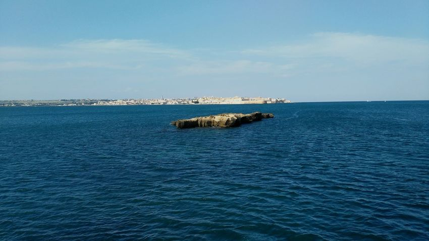 Sea Blue Beauty In Nature Day Sky No People Nature Scenics Outdoors Water Landscape Travel Italy Travelphotography Idyllic Travel Destinations Siracuse Seascape Sicily Rock Formation