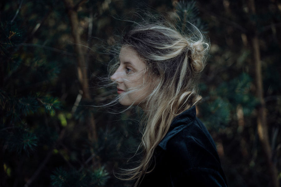 One Person Hair Tree Portrait Forest Headshot Focus On Foreground Hairstyle Looking Long Hair Real People Young Adult Leisure Activity Plant Land Lifestyles Side View Blond Hair Looking Away Contemplation Outdoors Beautiful Woman Warm Clothing