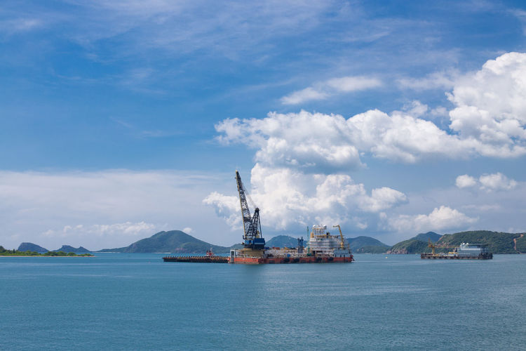 Industry Water Sky Cloud - Sky Sea Nature Day Waterfront No People Offshore Platform Architecture Oil Industry Crane - Construction Machinery Outdoors Fuel And Power Generation Machinery Blue Transportation Beauty In Nature Industrial Equipment