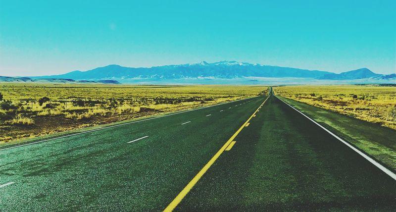 """The Long Black Ribbon"" U.S. Route 54 East toward Carrizozo, New Mexico and the Sierra Blanca Mountain Range. New Mexico Skies New Mexico Photography New Mexico Travel Asphalt Highways&Freeways Sky Landscape Road Scenics - Nature Transportation Diminishing Perspective vanishing point"