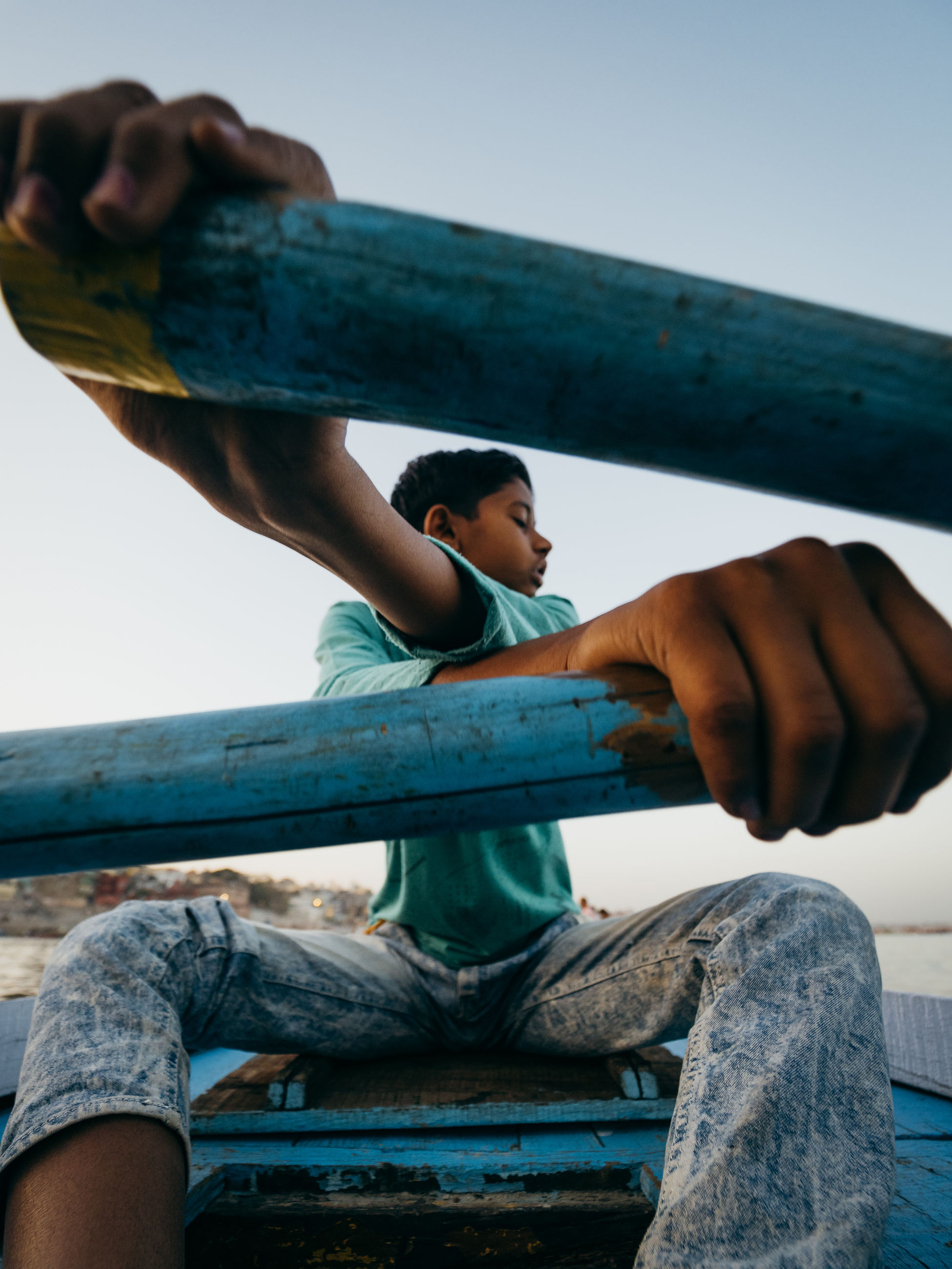child, boys, sky, real people, men, childhood, lifestyles, males, people, clear sky, focus on foreground, day, casual clothing, leisure activity, girls, wood - material, nature, low angle view, outdoors, jungle gym, human arm, innocence