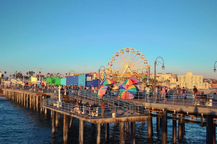 Santa Monica Pier Over Sea Against Clear Blue Sky
