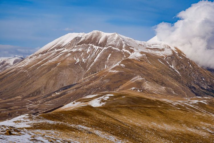 Scenic view of snowcapped mountain against sky in italy