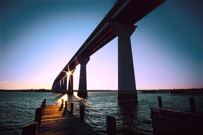 Not Selected For Market Solomons Island River Patuxent River Bridge Sunset Water Sea Pier Wood - Material Sunset Connection Tranquility Tranquil Scene Clear Sky Outdoors Built Structure No People Bridge - Man Made Structure Nature Sky Scenics Horizon Over Water Beauty In Nature Architecture Day