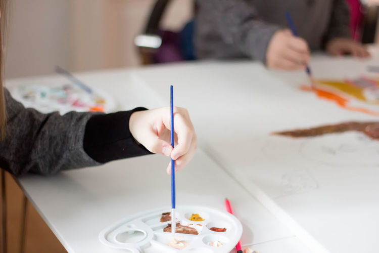 Children drawing Art And Craft Artist Close-up Creativity Focus On Foreground Food Food And Drink Freshness Holding Human Body Part Human Hand Indoors  Leisure Activity Midsection Multi Colored One Person Paintbrush Palette Paper Preparation  Ready-to-eat Real People Skill  Sweet Food Table