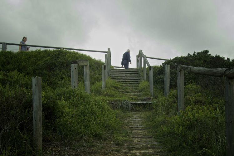 In Eurobodalla, Australia. Farewell Following Goodbye Grey Sky Long Goodbye Man And Woman Man And Woman Walking Sky Steps Two People Walking Wooden Posts