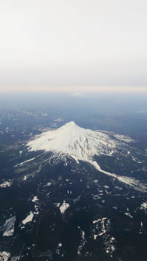 ascending to 37,000 ft, spotted Mount Hood at 11,000 ft. Mount Hood Aerial View Beauty In Nature Cloud - Sky From The Plane Window Horizon Line Mountain Nature Outdoors Snow Capped Mountain Tranquil Scene The Great Outdoors - 2018 EyeEm Awards