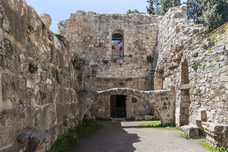 Jerusalem, Israel, March 09, 2019 : Ancient ruins in the courtyard of Pools of Bethesda in the old city of Jerusalem, Israel Tank Roman Cistern Heritage Historic Brick Wall Stone Material Damaged Arch Remains Landmark Ruins Christianity Excavations Scenic View Ancient Archaeological Religion And Beliefs Culture Antique Architecture Jerusalem Israel Old City Church Of Saint Anne And The Pools Of Bethesda Worship