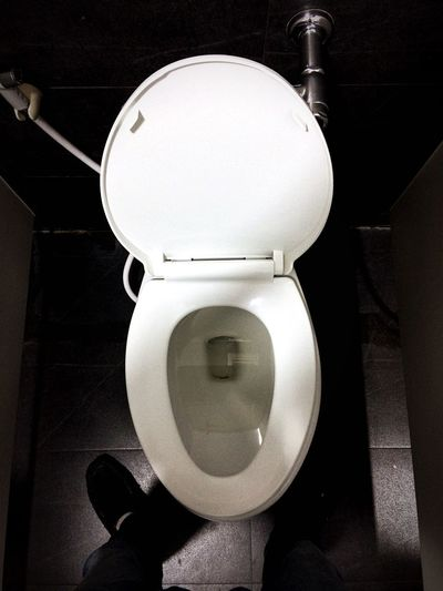 People are standing urinating on the toilet Flush Toilet Urine Toilet Man Toilet Indoors  Bathroom Toilet Bowl High Angle View Close-up Domestic Room Arts Culture And Entertainment White Color Wall - Building Feature Household Fixture