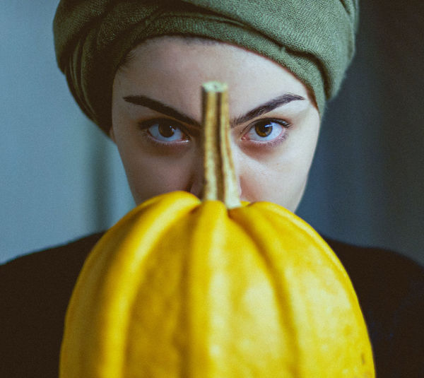 Portrait of woman with pumpkin