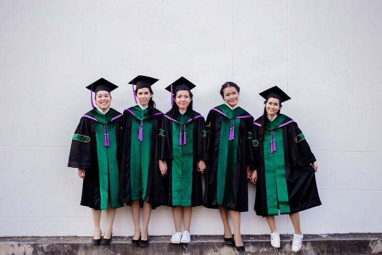 Maejo University Chiang Mai | Thailand Economics Student Life Education In A Row Graduation Studio Shot Standing Achievement Portrait University Friendship University Student Student People Young Women Adult White Background Men Smiling Adult Student Diploma Young Adult
