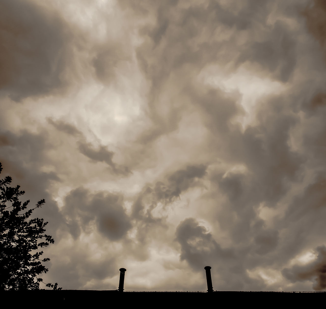 cloud - sky, sky, nature, weather, no people, beauty in nature, tree, storm cloud, scenics, tranquility, outdoors, day, low angle view, silhouette