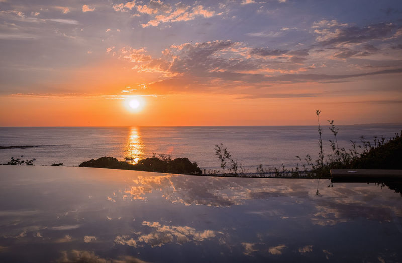 Sunset Sky Water Cloud - Sky Scenics - Nature Beauty In Nature Tranquility Tranquil Scene Reflection Orange Color Nature Sea Idyllic No People Sun Horizon Over Water Horizon Sunlight Non-urban Scene Outdoors Manta Manta Ray