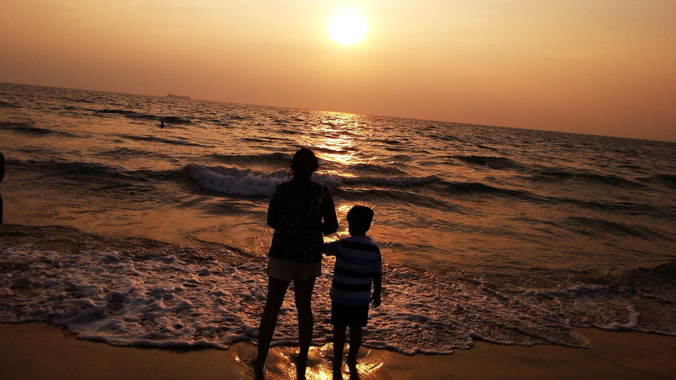 Sunset in Goa Beach EyeEmNewHere Horizon Over Water Lifestyles Nature Rakeshtiwari Real People Rear View Sand Scenics Sea Silhouette Sky Standing Sun Sunset Togetherness Tranquil Scene Tranquility Two People Vacations Water Wave Live For The Story