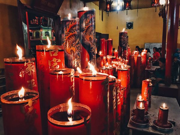 The Red Candles Flame Burning Candle Illuminated Indoors  Religion Lit Spirituality Heat - Temperature Real People Place Of Worship EyeEm Best Shots Eye4photography  EyeEm Gallery EyeEm Best Edits Vscocam