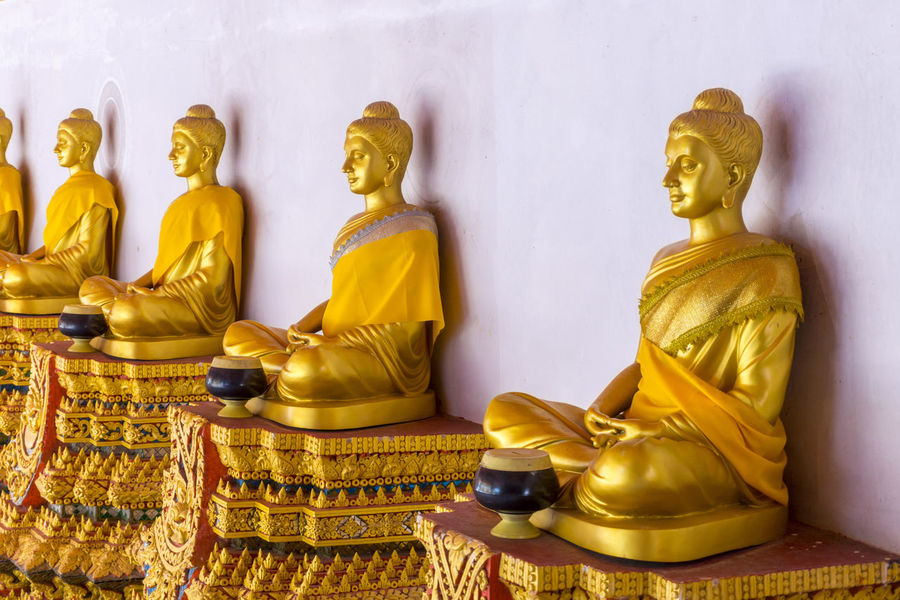 Buddha Statues along a Wall Buddha Buddha Statue Buddhism Day Gold Gold Colored Golden Golden Golden Color Human Representation Idol Indoors  Male Likeness No People Place Of Worship Religion Sculpture Spirituality Statue
