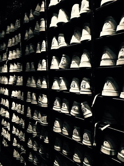 In A Row Large Group Of Objects Shelf Indoors  No People Close-up Day Lot Of Shoes Bowlen Different Sizes