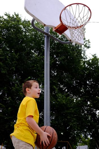 Watch out for falling balls Daddy! Candid Shot Shooting Hoops At The Park Having Fun Basketball