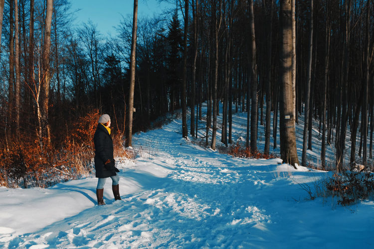 Beautiful woman walking in the snow alone social distancing