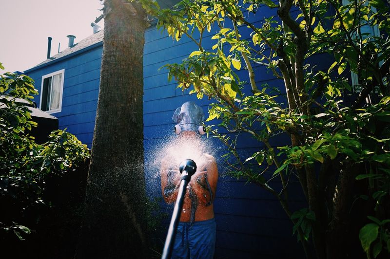 Man spraying water