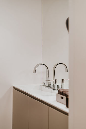 Sink Bathroom Faucet Indoors  Domestic Room Domestic Bathroom No People Home Household Equipment Hygiene Bathroom Sink Reflection Home Interior Mirror Absence Wall - Building Feature Simplicity Modern Home Showcase Interior Tile Luxury