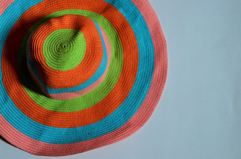 High angle view of colorful sun hat on table