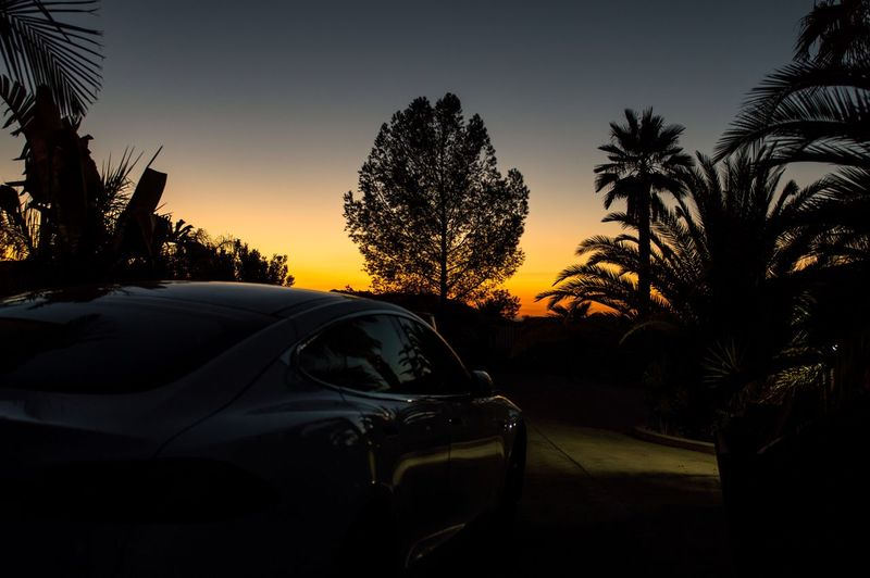 Silhouette of car at sunset