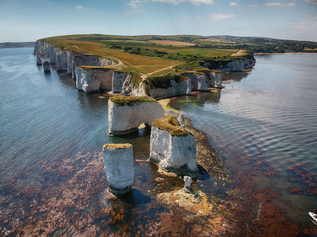 Old Harry Rocks Drone  Aerial View Architecture Beauty In Nature Built Structure Day Dronephotography High Angle View Lake Nature No People Outdoors Reflection Rock Scenics - Nature Sky Solid Tranquil Scene Tranquility Water Waterfront