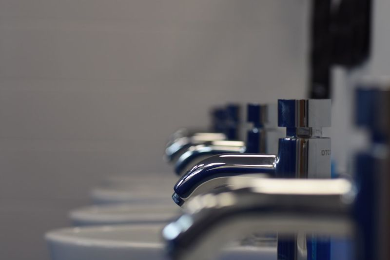 Close-Up Of Faucets