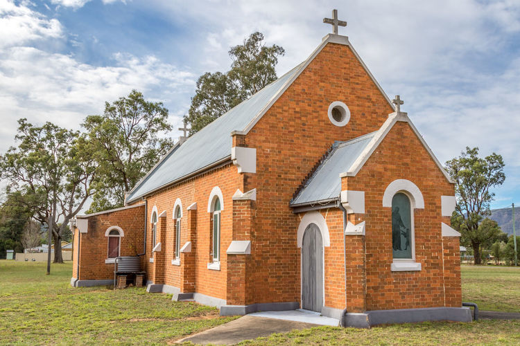 Country church in rural setting Australia Australian Chapel Church Cloudy Country Cross Grass Grave Rural Trees Worship Architecture Brick Built Structure Clouds And Sky Country Day No People Outdoors Religion Rural Scene Sky Stone Windows