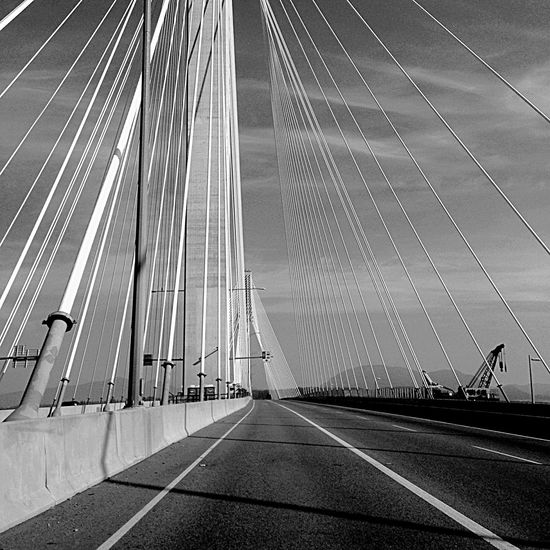 Shades Of Grey All My Photos Taken With IPhone5 B&w B&w Photography Bridge Wires Road Sky Beautiful This is the Port Mann bridge in British Columbia Canada, and these are the stay wires that help support it. This is truly a beautiful bridge.