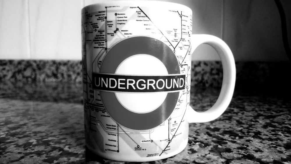 London Underground Black And White Blackandwhite Circle Close-up Coffee Cup Communication Cup Cup Of Coffee Day Design Drink Focus On Foreground Food And Drink Information Monochrome Mug No People Shape Still Life Text Thematic Mug Western Script