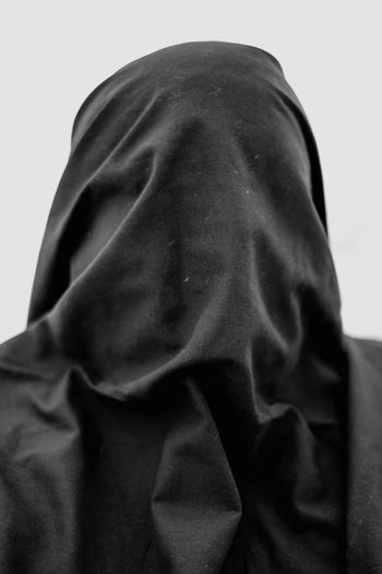 Close-up portrait of a woman covering face
