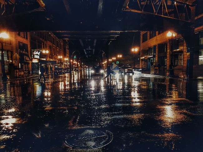 Reflection Illuminated Night Wet Water People Outdoors Cityscape Check This Out Taking Photos Chicago Downtown Chicago Rain Rain Reflection Night Lights Street Photography