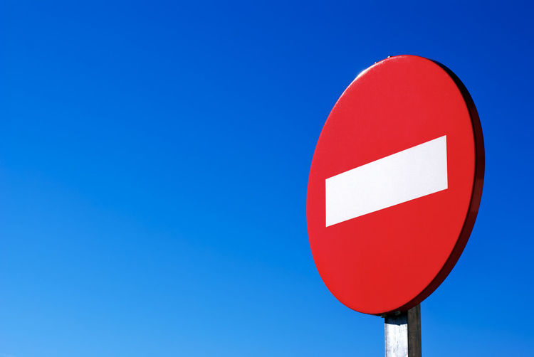 Blue Circle Clear Sky Communication Copy Space Do Not Enter Sign Forbidden Geometric Shape Guidance Low Angle View Nature No People Outdoors Red Road Road Sign Round Shape Sign Sky Stop Sign Warning Sign Warning Symbol