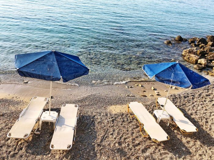 Sunbed Sandy Sandy Sea Umbrella Water High Angle View Umbrella Nature Day Beach Outdoors Sea Protection Sunlight No People
