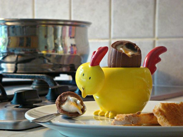 chocolate easter egg in chick egg cup Chocolate Easter Boiled Egg Breakfast Egg Breakfast Time Chick Chocolate Egg Creme Egg Easter Chicks Egg Cup Runny Egg Sweet