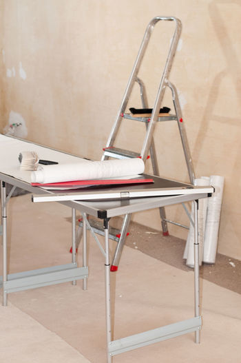 Step Ladder Indoors  No People Flooring Ladder Seat Absence Metal Furniture Chair Table Wood - Material Empty Still Life Tiled Floor Wall - Building Feature Architecture Tile Equipment Day