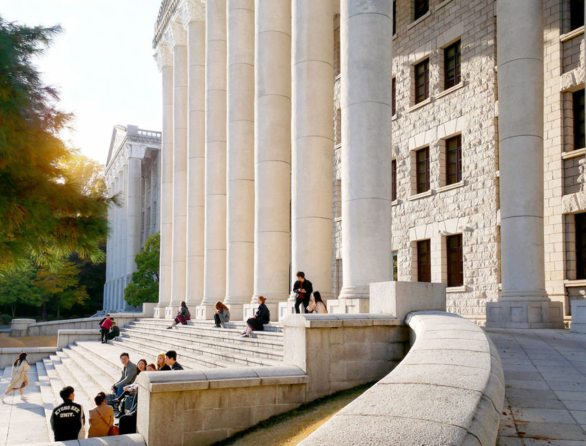 Students are having a relaxing time at the campus in Kyung Hee University in Seoul, Korea. ASIA Architecture Campus Famous Korea Kyung Hee University Seoul Students Teenagers  Youth Building Built Structure Education Relax Study University Western