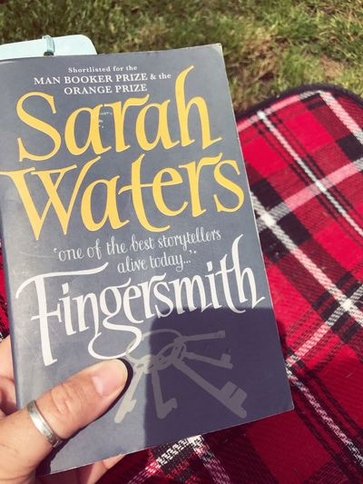 Summer Me Enjoying The Sun In My Garden Reading A Book Text Human Hand Western Script Communication Human Body Part Day Me Time ♥ Outdoors Enjoying The Sun Relaxing Close-up Fingersmith Chequered Picnic Blanket Sarah Waters