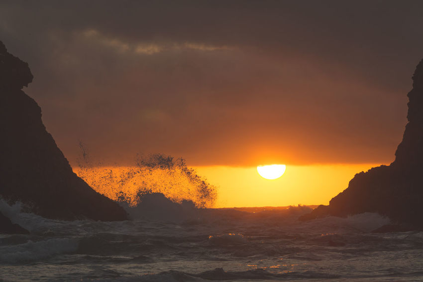 Waves crashing under dramatic orange sunset. EyeEmNewHere Beauty In Nature Day Force Motion Nature No People Orange Color Outdoors Power In Nature Scenics Sea Silhouette Sky Sun Sunset Water Wave