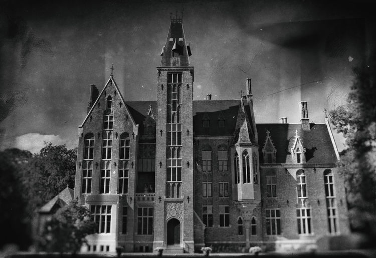 Loppem Castle : http://www.kasteelvanloppem.be/index.html Architecture Being Creative Black And White Building Exterior Building Story Built Structure Castle Extreme Edit EyeEm Best Edits EyeEm Best Shots Façade Historic History Kasteel Van Loppem Monochromatic Monochrome My Art, My Soul... My Unique Style Nik Collection Popular Photos Sony ILCA-68K Taking Photos Tower Wet Plate