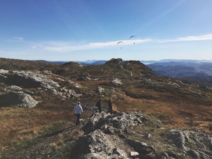 High angle view of friends hiking on mountain against sky