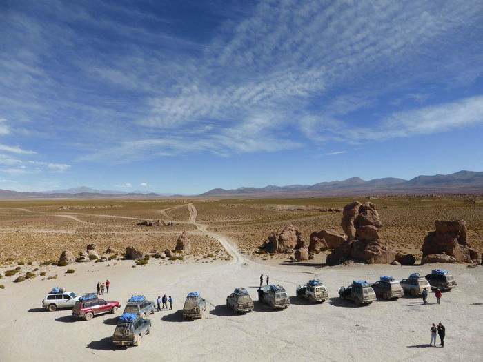 High Angle View Of People And Sport Utility Vehicles At Desert