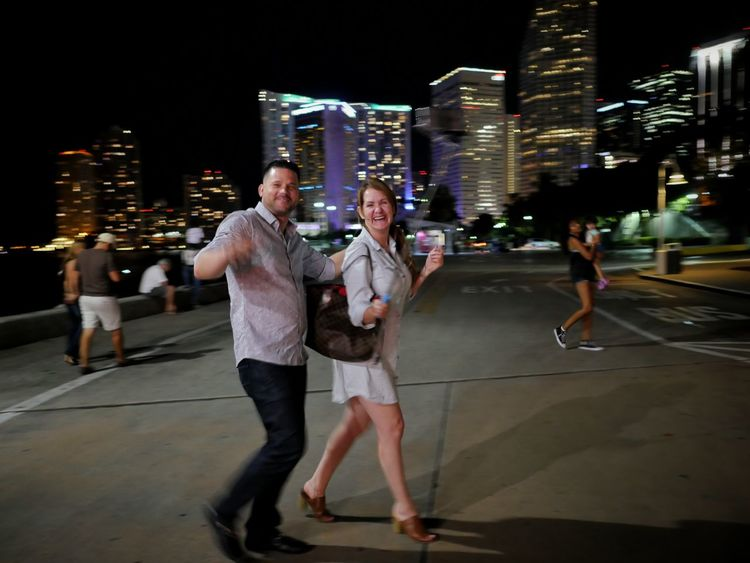 Happy couple strolling the harbor walk at Bayside in Miami. Streetphotography Night Photography Harbor Miami Happy People Motion Street Photography Lumixlounge GX8 Up Close Street Photography