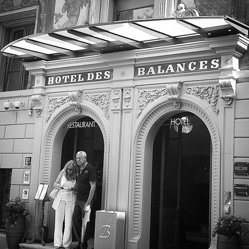 An elderly couple just stepped out of Hotel des Balances in the old town of Luzern. Streetphoto_bw Strangers Poweroftwo Switzerland
