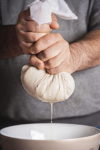 Close-up of man preparing food in kitchen
