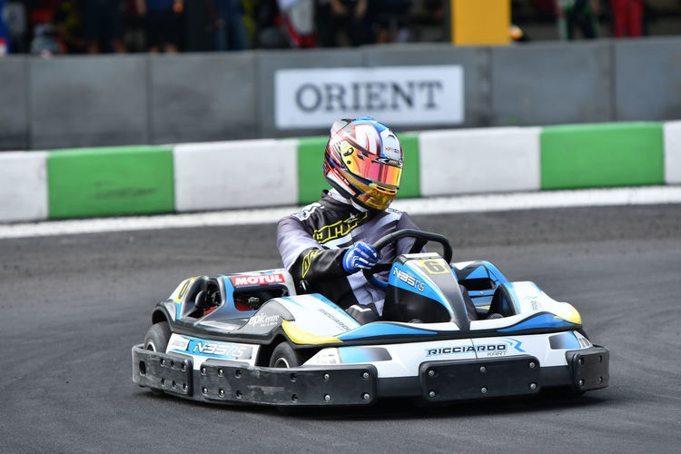 Sports Race Competition Sport Motorsport Motor Racing Track One Person Transportation Sports Helmet Racecar Mode Of Transportation Crash Helmet Helmet Real People Headwear Day Driving Focus On Foreground Auto Racing Gokart