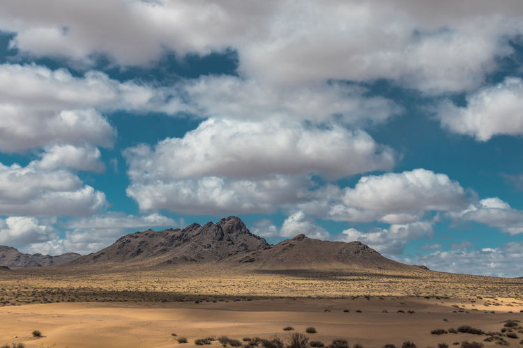 Mongolia Cloud - Sky Scenics - Nature Sky Landscape Beauty In Nature Environment Non-urban Scene Desert Mountain Tranquil Scene Land Tranquility Nature Climate Arid Climate Day No People Remote Sand Physical Geography Outdoors Salt Flat